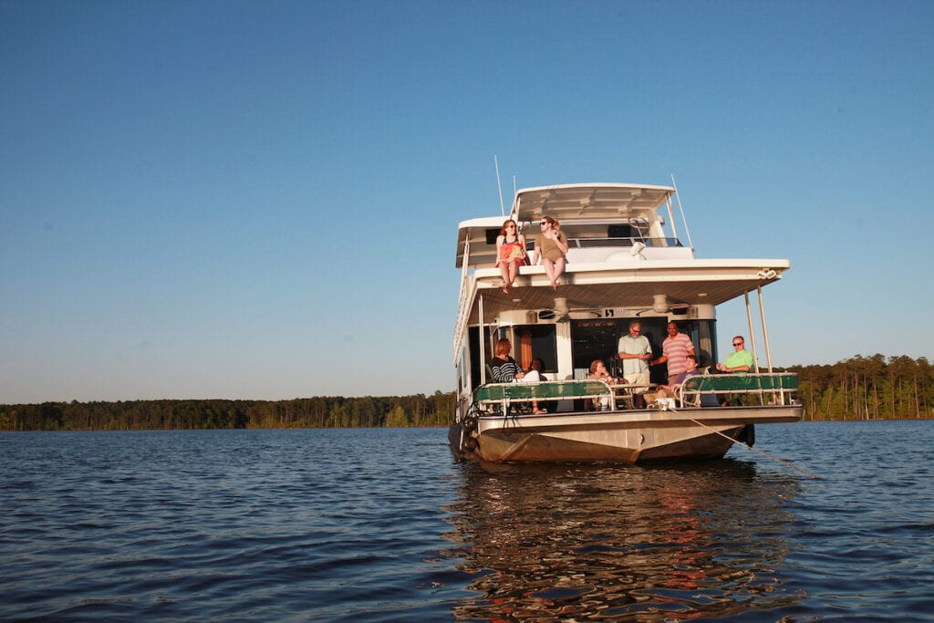 Paula and Greg Stafford with guests aboard their houseboat on Jordan Lake.