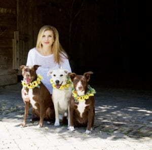 Carly Hemminger with her three dogs
