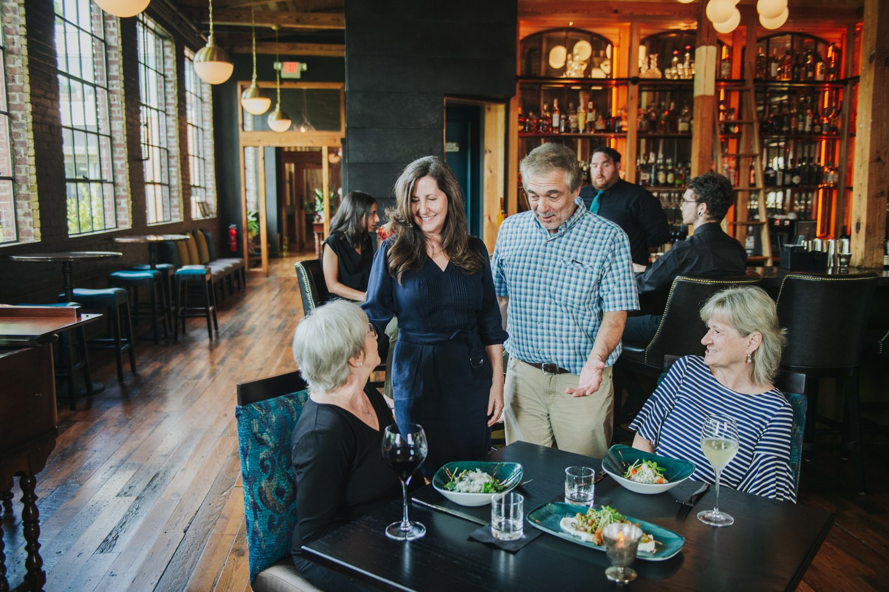 Greg Lewis and Maria Parker-Lewis, owners of The Sycamore at Chatham Mills who saw the pandemic impact their opening plans, stand and talk to customers.
